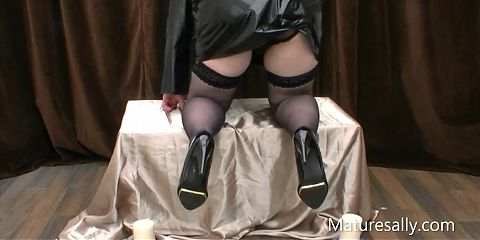 Naughty nun strips out of her pvc outfit