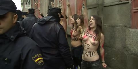 Topless FEMEN activists invade anti abortion demo in Madrid
