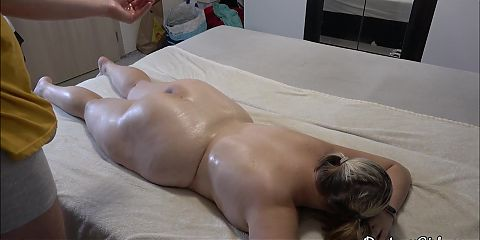 A tired chubby girl gets massage after a hard day
